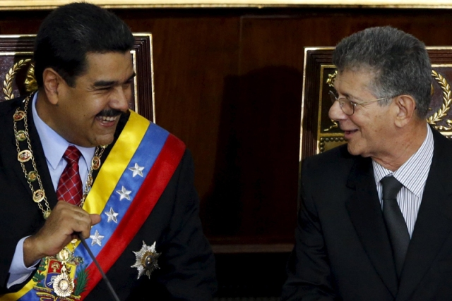 Venezuela's President Nicolas Maduro and Henry Ramos Allup, president of the National Assembly, smile during his annual report of the state of the nation in Caracas
